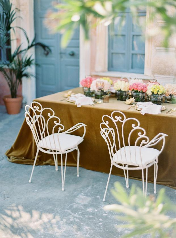 Fer forge wedding chairs and velvet tablecloth