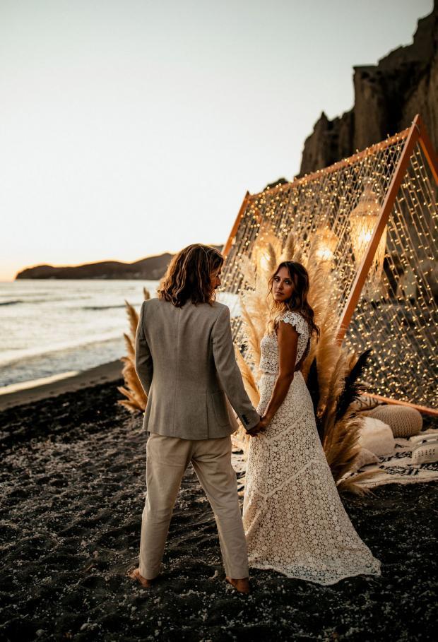 Fairy lights wedding dinner at the beach