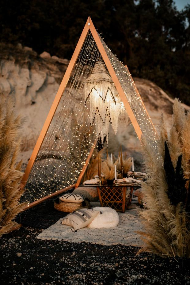 Boho beach wedding dinner -shell chandeliers