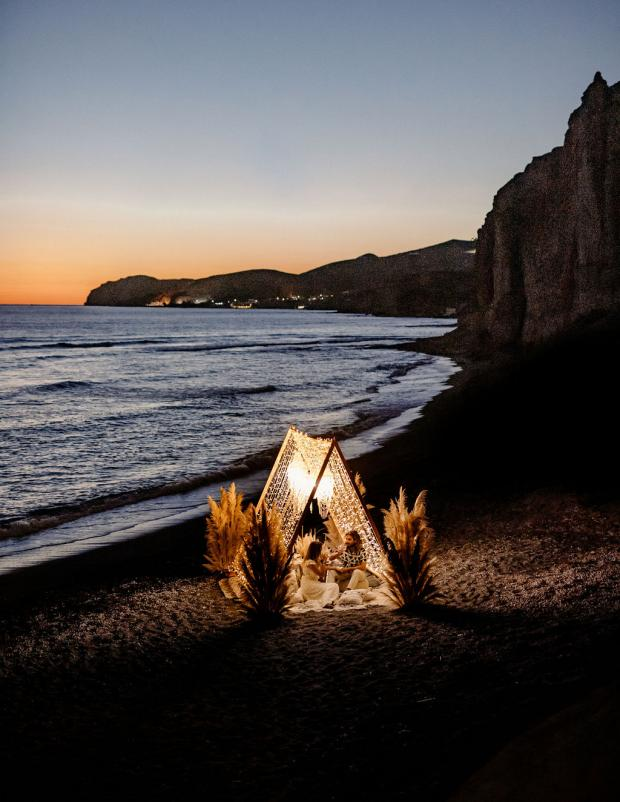 Romantic fairy lights dinner with pampas and shell chandeliers
