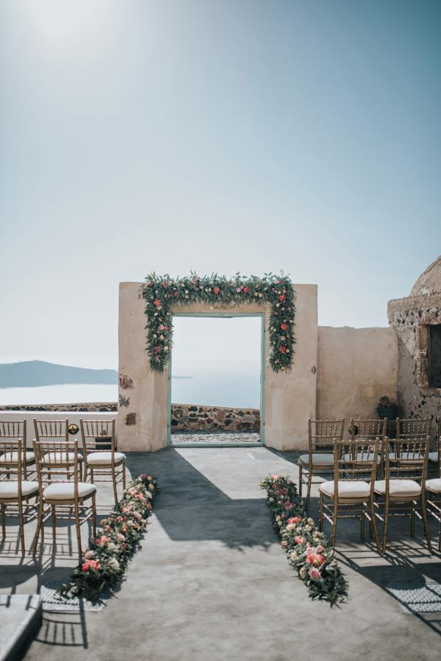 Wedding ceremony arch with peonies