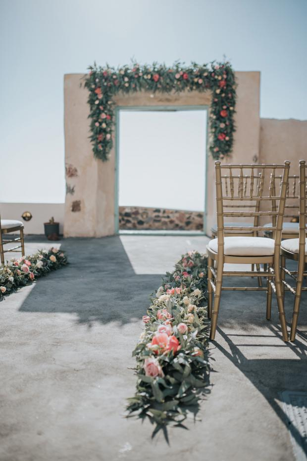 Wedding ceremony aisle with peonies