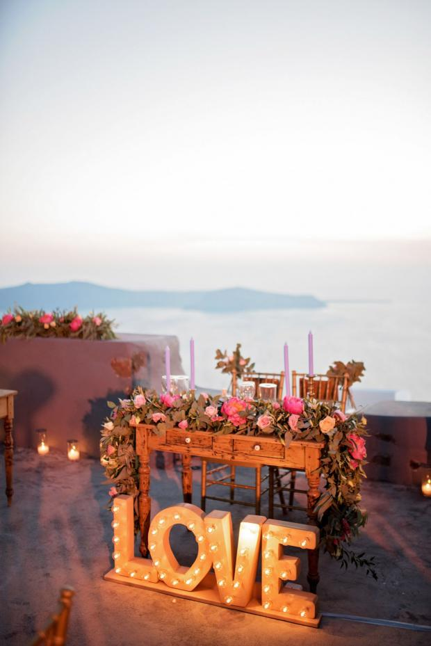 Romantic dinner in Santorini- Love sign