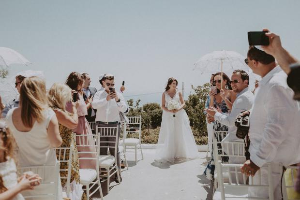 Bride walking down the aisle- Santorini wedding