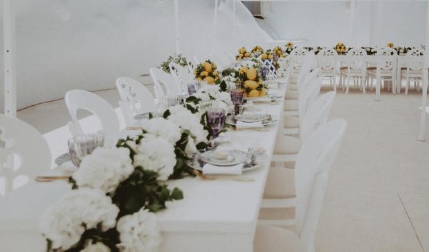 White - blue and lemon wedding reception in Greece