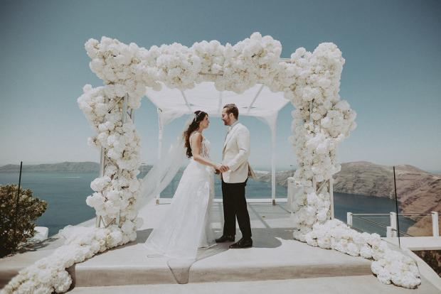 All  white luxury wedding arch- Wedding in Santorini, Greece