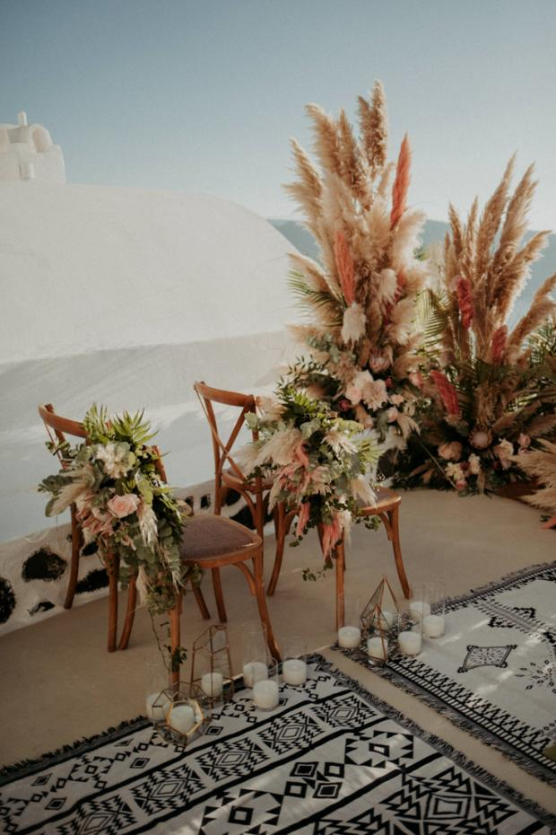 Pink pampas grass wedding ceremony- blue rugs aisle