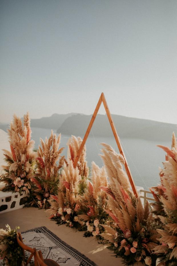 Pink pampas grass wedding ceremony-triangle arch